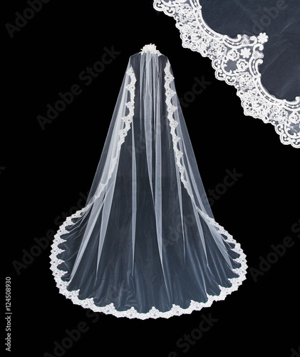 Fototapeta Isolated wedding white veil on a black background.