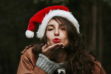 Young Woman With Santa Claus H...
