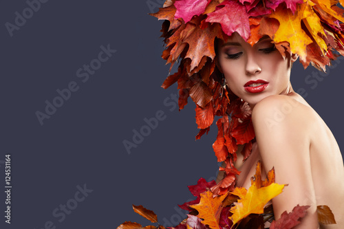 Fototapety, obrazy: Woman with leafs on head in autumn concept.