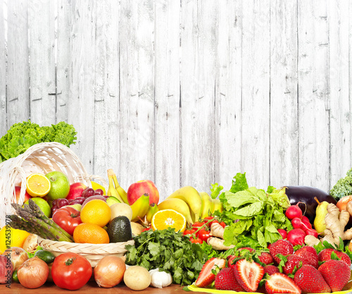 Poster Fruit Vegetables and fruits over white wall background.