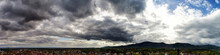 Panoramic View To The Valley And Stormy Cloudy Sky