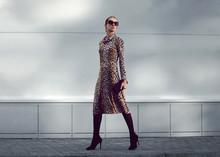 Elegant Woman Model In Leopard Dress Walking In Evening City, St