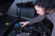 Distressed woman repair broken car