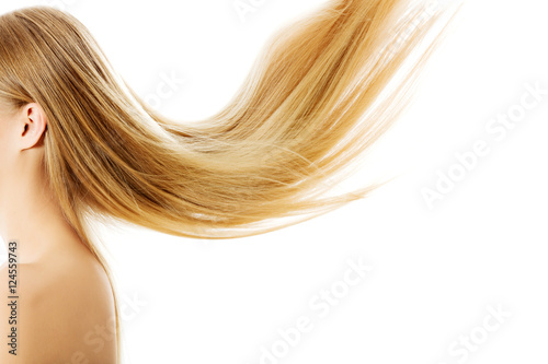 Plakát  Beautiful long blonde hair, isolated on white.