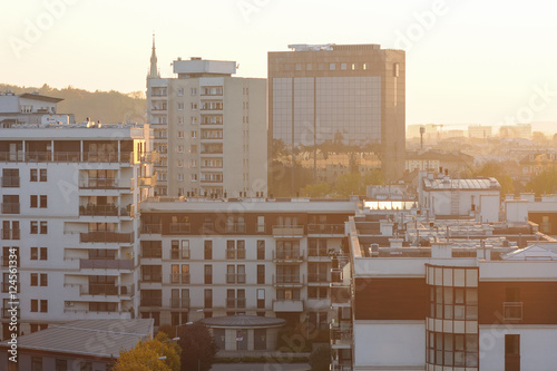 Fototapety, obrazy: City architecture with sunset across horizon. Urban background