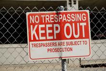 No Trespassing Sign On Fence O...