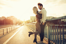 Couple Kissing Dating On Bridge