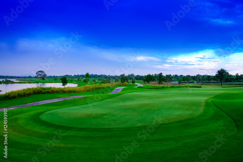 Landscape beautisul green golf links and blue sky