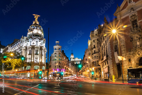 Poster Madrid Rays of traffic lights on Gran via street, main shopping street in Madrid at night. Spain, Europe.