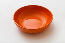 One Orange Bowl On White Plaster