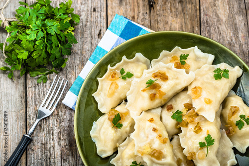 Russian dumplings with fried onion on plate, homemade cooking concept