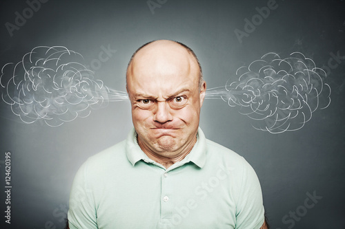 Fotografie, Obraz  Closeup portrait of angry man, blowing steam coming out of ears,