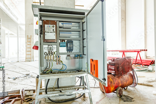 Photo Electricity distribution box with wires and circuit breakers. Fu