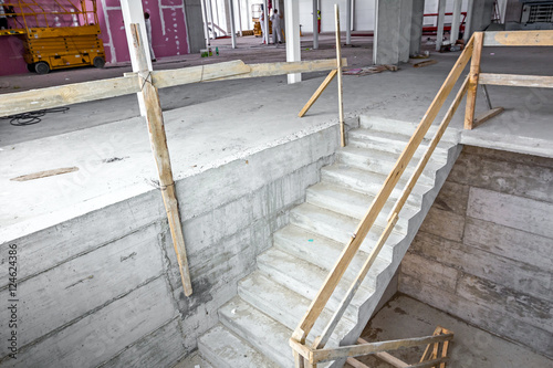 Photo Stands Stairs Unfinished staircase in concrete new building
