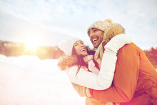 Happy Couple Hugging Outdoors In Winter
