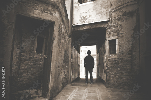 Fotografie, Obraz Man walking in a old mystic dark alley
