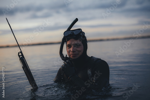 Spoed Foto op Canvas Duiken Happy underwater hunter with speargun