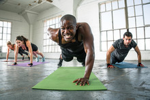 Trainer At Gym Leads Class Gro...
