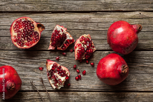 Fotografie, Obraz  Pomegranates on wooden table
