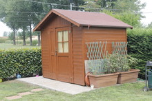 Wooden Shed For Tools In The Garden