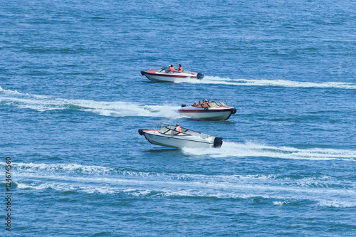 Garden Poster Water Motor sports Speed boats passing each other in a blue sea