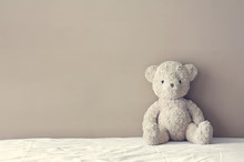 Vintage Teddy Bear Sit On The Right Side White Bed At Headboard