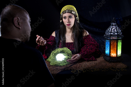 Vászonkép Gullible patron with scam artist or fraudulent psychic fortune teller