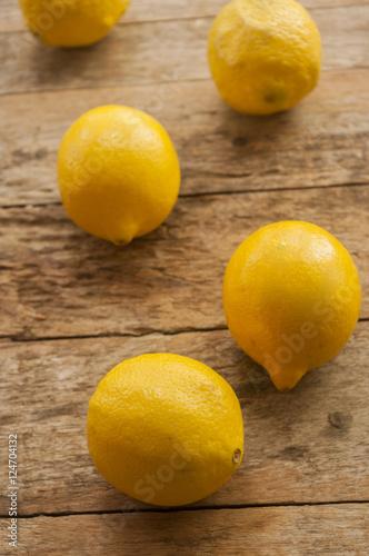Lemon on old wooden background.
