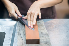 Sharpening The Knife With Whetstone