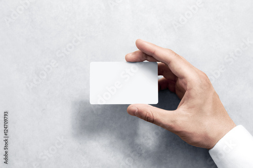 Photo  Hand hold blank white card mockup with rounded corners