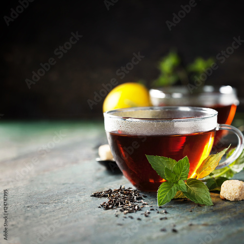Staande foto Thee Hot tea cup with mint and sugar