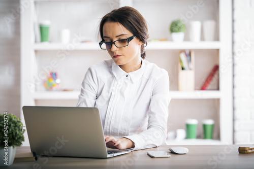 Fototapeta Attractive woman using laptop obraz na płótnie