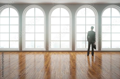Obraz Man looking out of window - fototapety do salonu