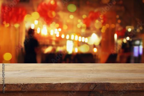 Fototapeta table in front of abstract blurred restaurant lights obraz na płótnie