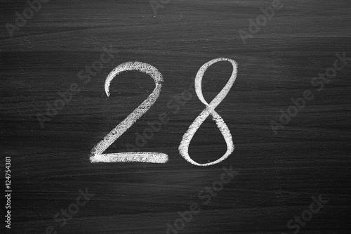 Fotografie, Tablou  number twenty eight enumeration written with a chalk on the blackboard