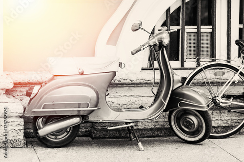 Foto op Canvas Scooter Motorbike parked on the street. Vintage filter applied.