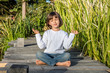 smiling beautiful child doing yoga bare feet for relaxing energy