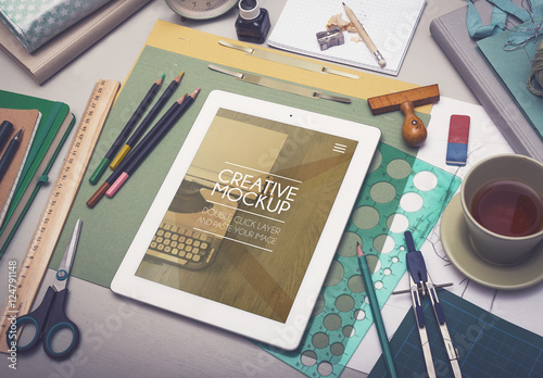 Tablet Art and Drafting Supplies on Desk Mockup Buy this stock
