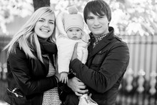 Young Family With Baby In Autumn Park. Black - White Photo