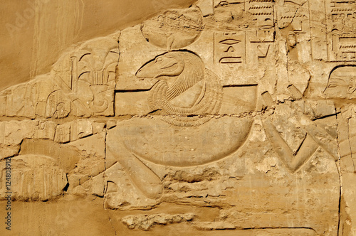 Fototapety, obrazy: Ancient Egypt. The wall are decorated with carved hieroglyphs. Karnak Temple. Luxor. Thebes.