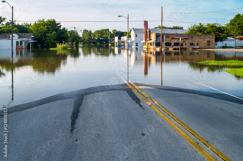 Foto Flooded business street in a small town.