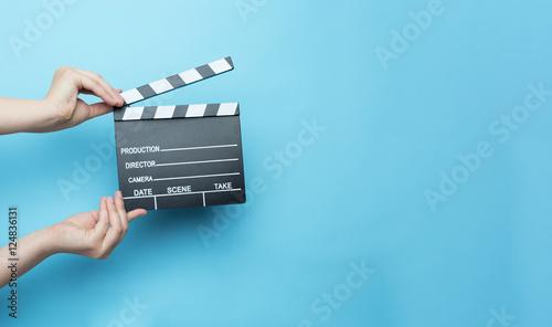 Vászonkép movie clapper on blue background, cinema concept