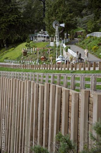 Fototapeta boat n white fence obraz na płótnie