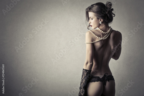 Sensual lady wearing pearls