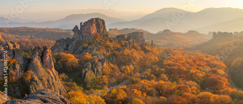 Spoed Foto op Canvas Beige Belogradchik rocks at sunset / Magnificent panoramic sunset view of the Belogradchik rocks in Bulgaria, lit by the last rays of autumn sun