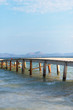 Old wooden pier leading to the sea.