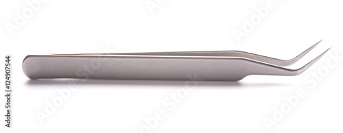 Fotografía  Metal tweezers for gluing eyelashes on a white background