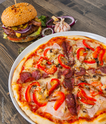 burger and pizza on a wooden table © pavel siamionov