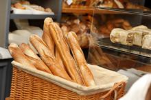 French Baguettes In Wicker Basket In Bakery