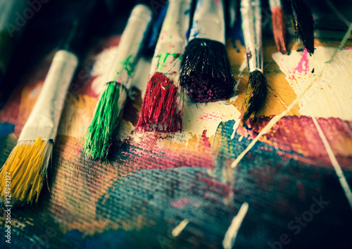 Artist paint brush on painting background